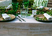 A table decorated with birch twigs and banners