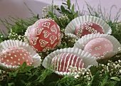 Decorated Easter eggs in paper cases