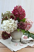 An autumnal bouquet of hortensias in a stone vase