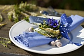 A napkin with a heather wreath and gentianas
