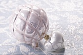 Silver Christmas baubles and a heart decoration