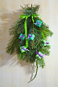 Small Christmas wreath hanging on a door