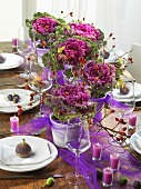 Attractively laid table with ornamental cabbage, rose hips, figs