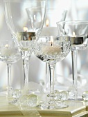 Tea lights in cut glass wine glasses