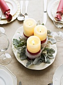 Christmas table decoration with three candles