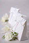 Paper bags with white roses