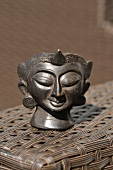 Bronze head from Burma being used as an ashtray