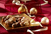 Different nuts on a golden plate with Christmas decorations