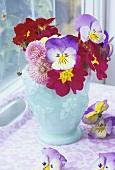 Vase of flowers by window