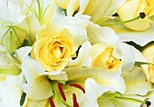 A wedding bouquet of yellow roses and white lilies