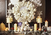 White Christmas decoration (wreath, candles)