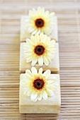 Three bars of soap with chrysanthemum flowers