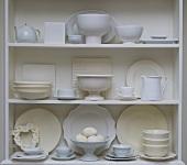 White crockery and eggs on shelves