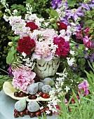 Fresh figs, cherries and vase of summer flowers