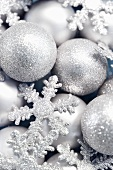 Silver Christmas baubles and snowflakes, full-frame