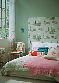 Double bed with wallpapered head