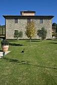 Mediterranean country home with stone facade and garden