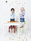 Children with colorful gummy bears