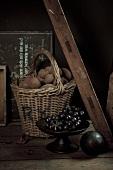 A rustic arrangement of potatoes and grapes