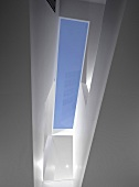 A view of a skylight in a modern, newly built house