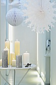 A hallway decorated for Christmas with paper stars and candles