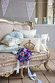 A bride's bouquet on an antique sofa