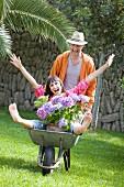 Young couple having fun gardening