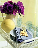 A Tray with Flowers, Plates, Napkins and Utensils