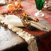 Autumnal place setting with fabric napkin and fork