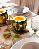 A Table Setting with Acorn Squash Lanterns
