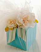 A Bridal Gift Wrapped in Blue Paper with Roses