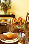 Table Set with Gourds and Autumn Floral Centerpiece