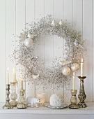 Christmas decorations with candles and a wreath on the wall