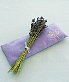 Lavender flowers on a lavender eye pillow