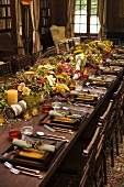 Large Dinner Table Set with Autumn Place Settings and Centerpiece