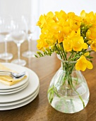 Yellow Freesia Flowers in a Vase on Table