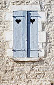 Wooden Shutters with Hearts Cut Out; French Countryside