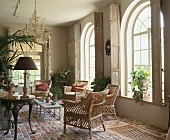 An orangerie with wicker chairs