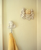 Angel figures and a towel hanging on the wall