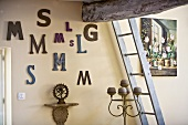Letters on a wall and a ladder