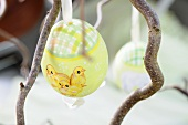 A painted Easter egg on a twig