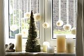 White window decoration with candles