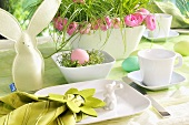 Breakfast place setting with an Easter bunny and an Easter nest