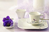 Festively decorated breakfast crockery with purple flowers