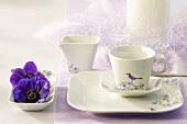 Festively decorated breakfast crockery with purple flowers