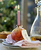 A pomegranate as a candle holder