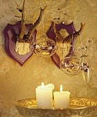 Christmas decoration hanging on antlers in candlelight