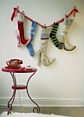 Fabric high-heels and socks hung of the wall for Father Christmas