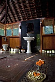 A bathroom in an Indian wooden hut