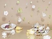 An artistic breakfast arrangement with hanging porcelain flowers
